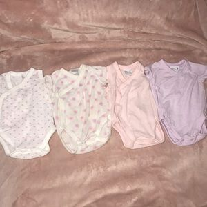 4 0-3 onesies for a baby girl